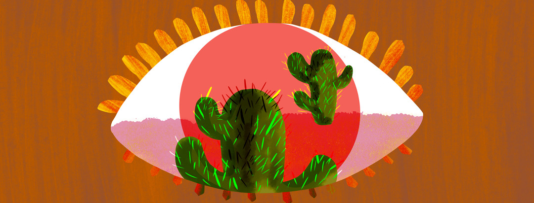An eyeball with a hot and dry desert scene within the iris