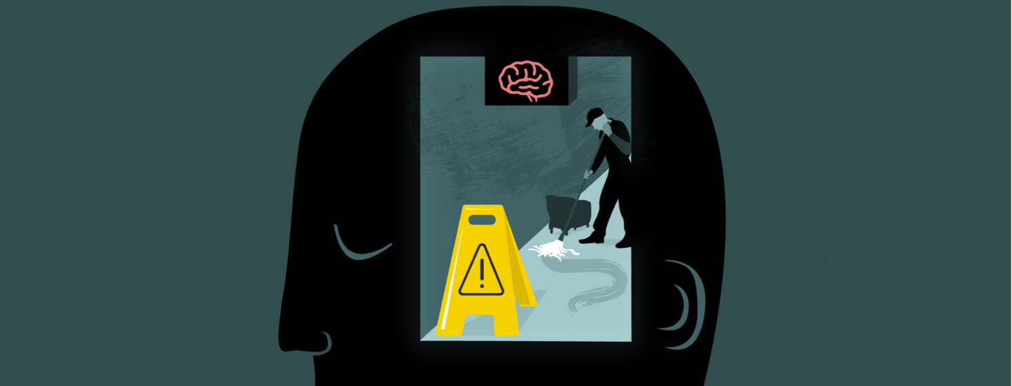 View into a person's head where there is a caution sign and someone is doing maintenance