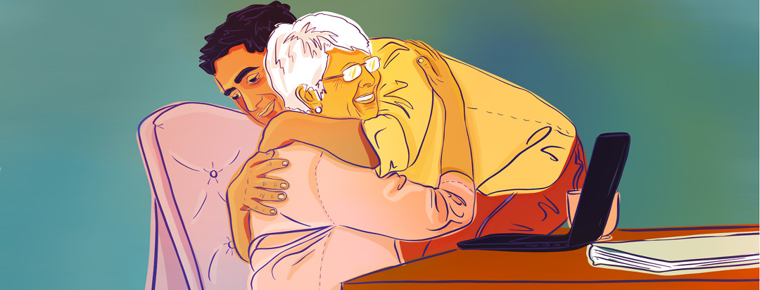 An adult son caregiver embraces his aging mother in a warm hug.