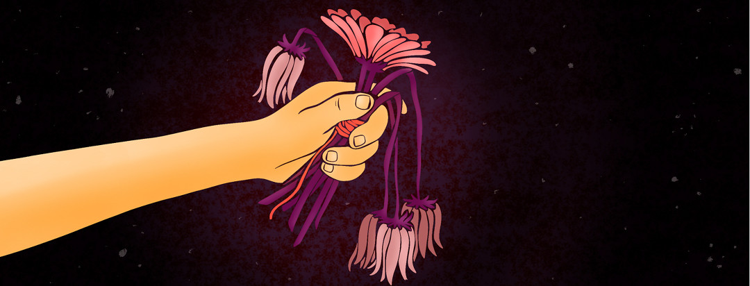A hand holds out a bouquet of wilted flowers.