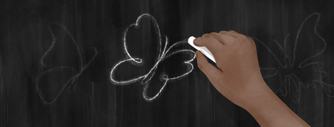 A hand draws a lupus butterfly in chalk on a chalkboard.