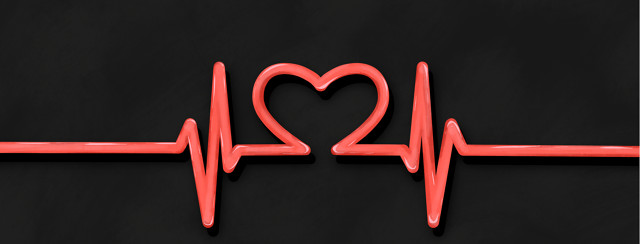 A heart monitor line forms the shape of a heart in the middle.