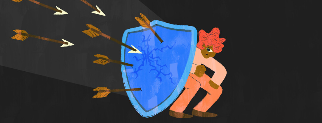 A person cowers behind a cracked shield with arrows approaching it.