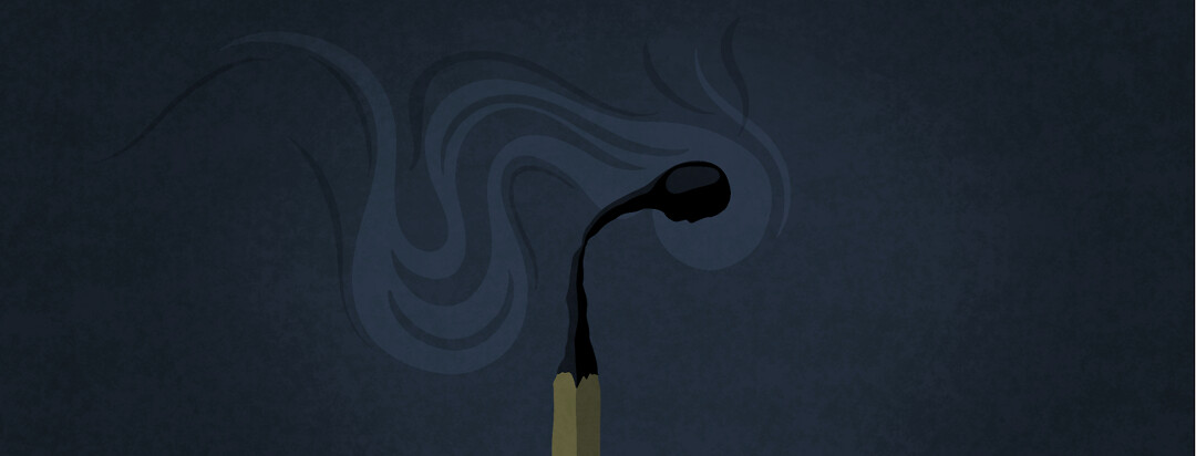 A burnt out and smoking match with a person's profile in the match head.