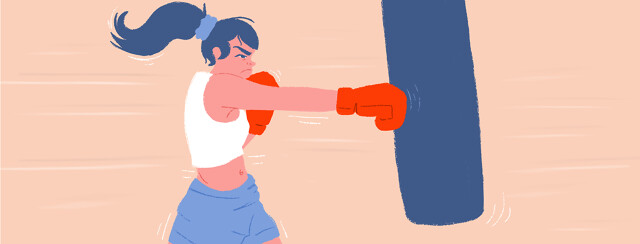 A female boxer punching the bag.