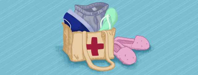 A canvas bag with a red cross patch filled with soft pants, underwear, and slip-on shoes.