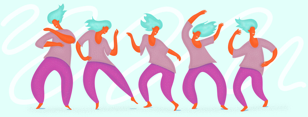 A woman freely moving her body around and dancing happily.