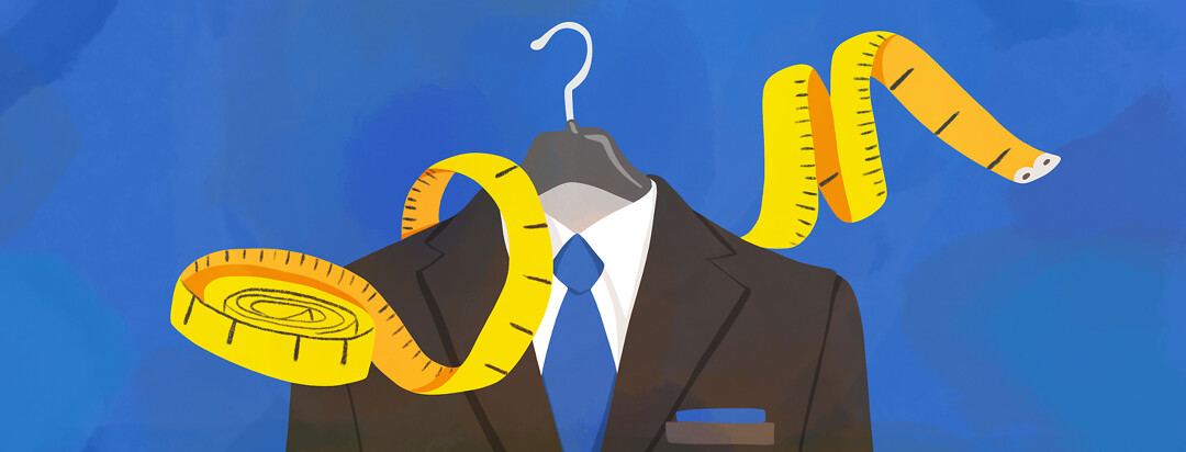 A suit hangs on a hanger as a measuring tape winds around it.